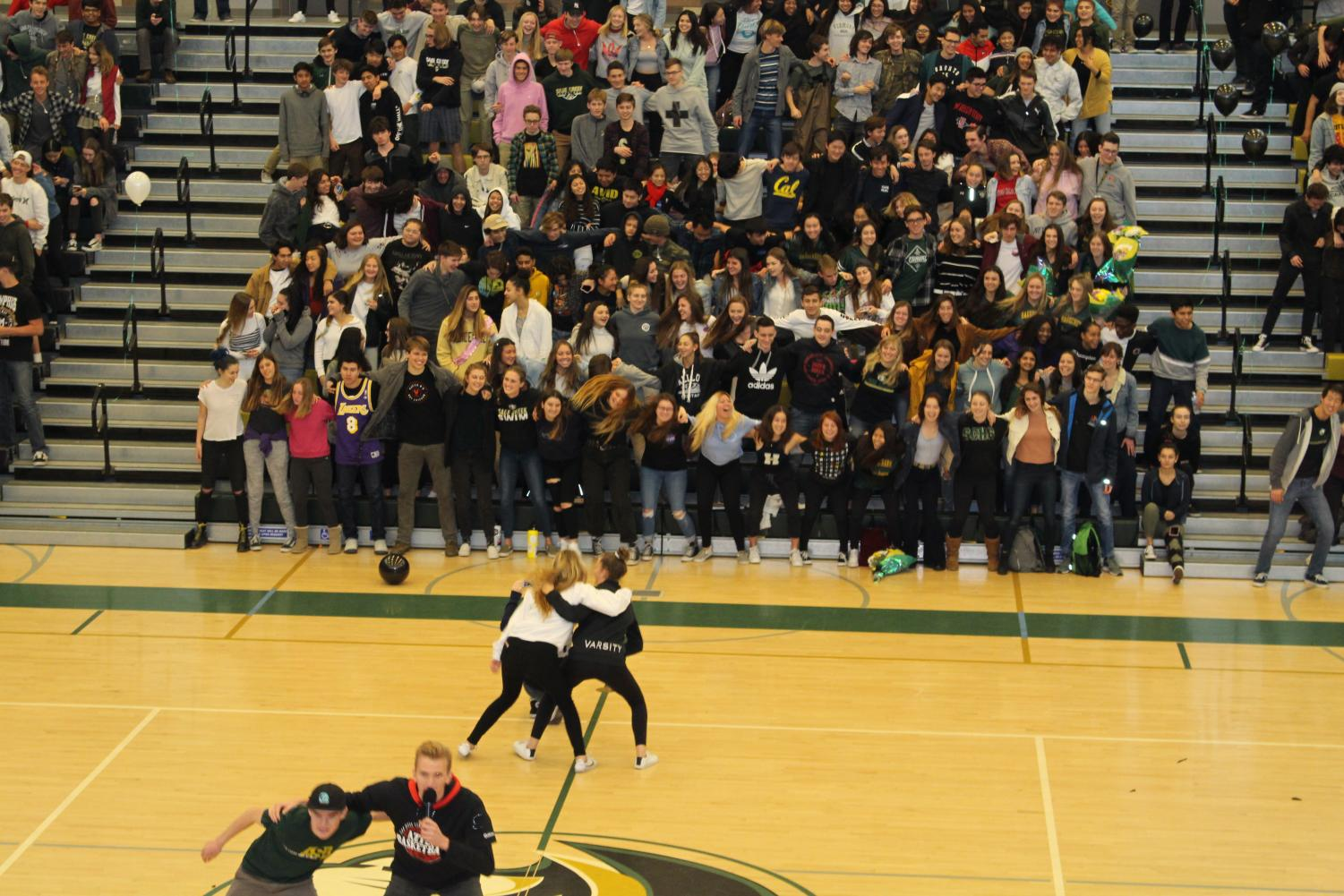 ASB+members+Cierra+Healy+and+Mary+Feldmann+sway+back+and+forth+during+last+weeks+pep+rally%2C+teaching+the+upper+classman+a+new+cheer+to+use+at+spring+sports+games.+Last+friday%2C+the+recognition+rally+recognized+students+and+faculty+for+various+departments+and+around+campus.