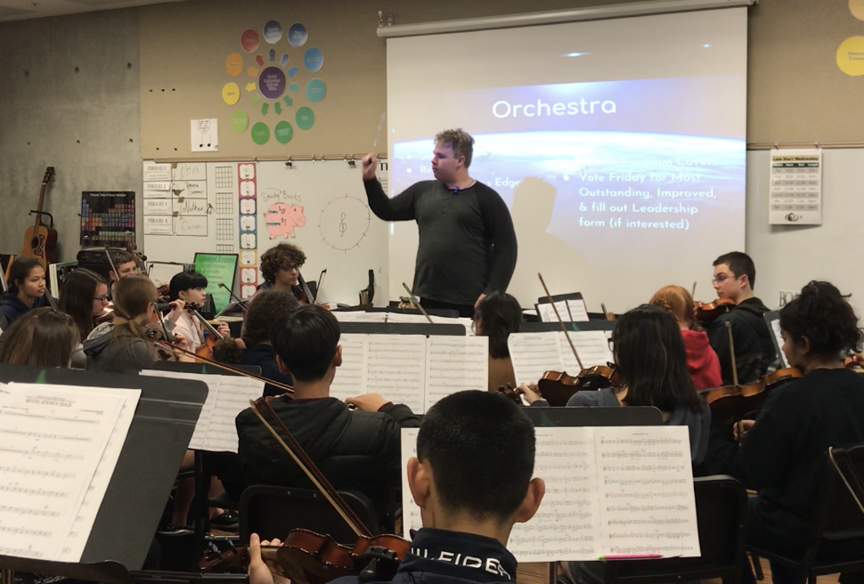 Sophomore EJ Hardy conducts during orchestra in preparation for their upcoming concert. The Spring Concert will be on Thursday, Feb. 28 in the Performing Arts Center.