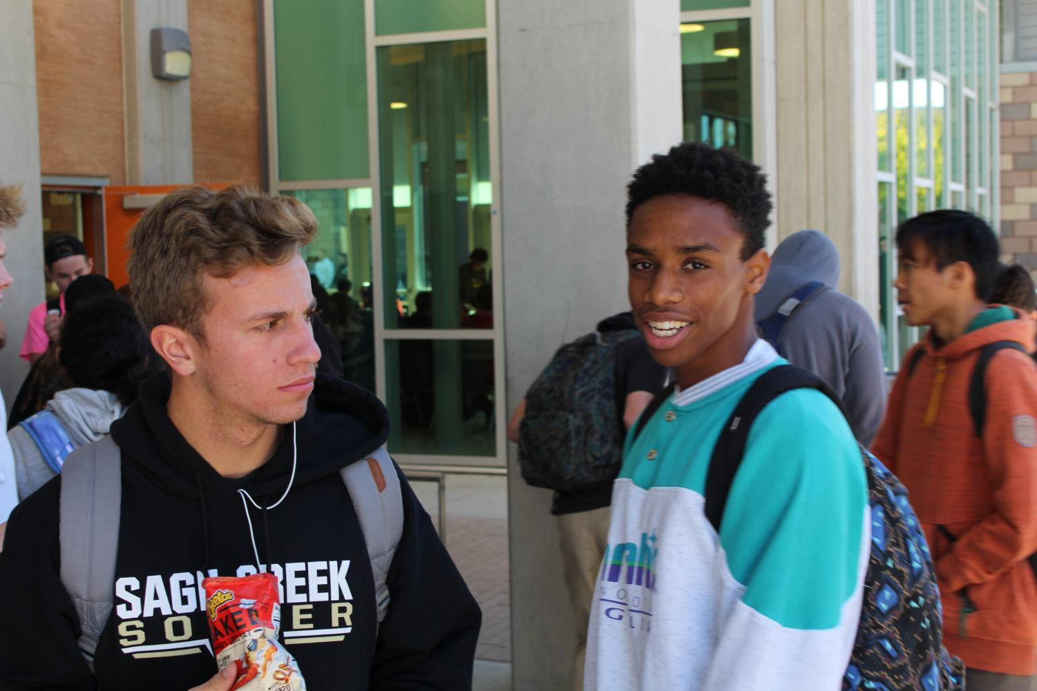 Titus Washington and Jet Trask wait in line to buy lunch. Both Washington and Trask are going to play collegiate soccer at Sacramento State University in the Fall.