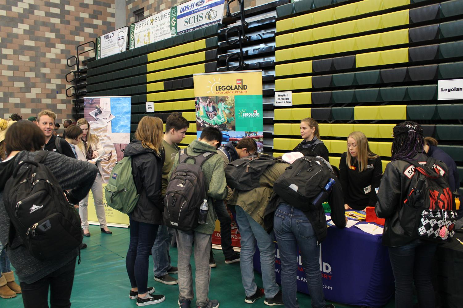 Students+line+up+in+front+of+the+Legoland+job+stand+to+get+information+about+potential+jobs.+The+JIVE+Expo+offered+many+jobs+for+students+ranging+from+Jersey+Mike%E2%80%99s+Subs+to+the+Wave+Waterpark.+