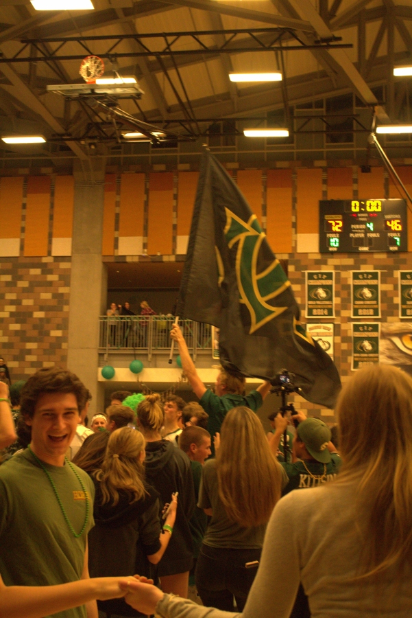 After+an+impressive+72-+46+win+for+the+boys+basketball+team+against+Oceanside+High+School%2C+Bobcat+fans+take+to+the+court+to+celebrate+the+victory.+