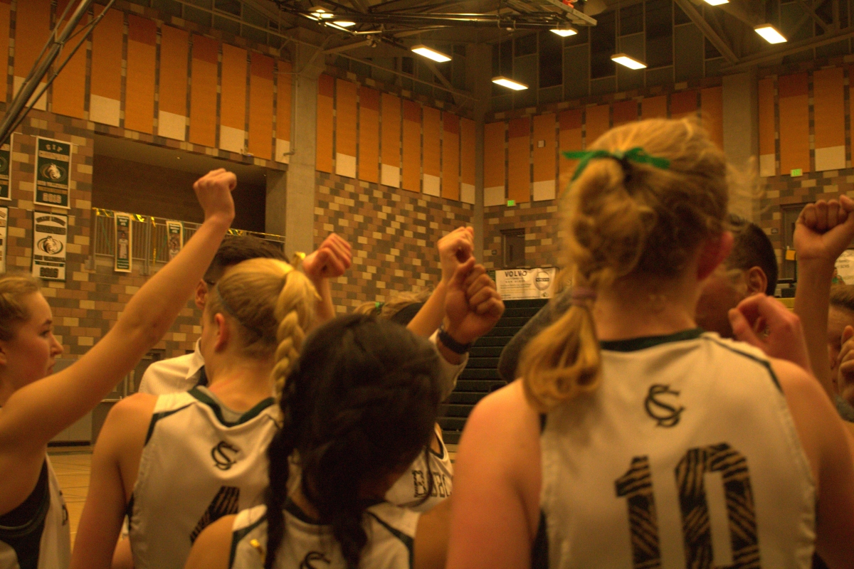 The+girls+basketball+team+cheers+before+heading+onto+the+court+for+the+final+quarter.+The+team+won+against+Oceanside+42-+24.+