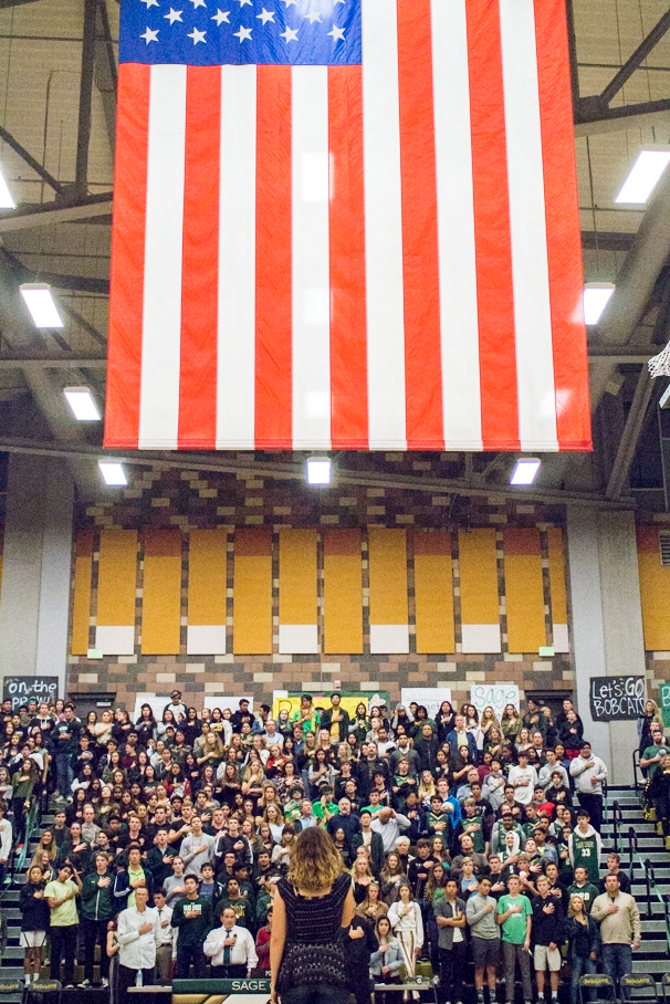 Junior+Priya+Richard+performs+the+National+Anthem+in+front+of+Sage+Creek+fans%2C+students%2C+members+and+staff.+Richard+has+been+performing+the+anthem+for+Hoopcoming+for+two+years+now.+