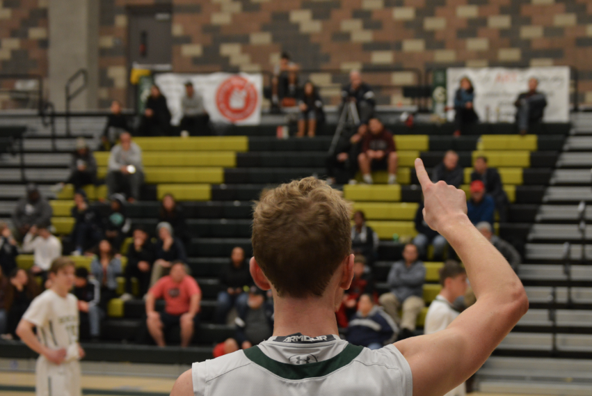Senior+and+varsity+boys+basketball+captain+Nick+Sonck+bringing+the+energy+and+the+support+not+only+from+on+the+court+but+from+the+stands.+He+raises+the+number+one+for+his+fellow+teammate+taking+a+free+throw.+