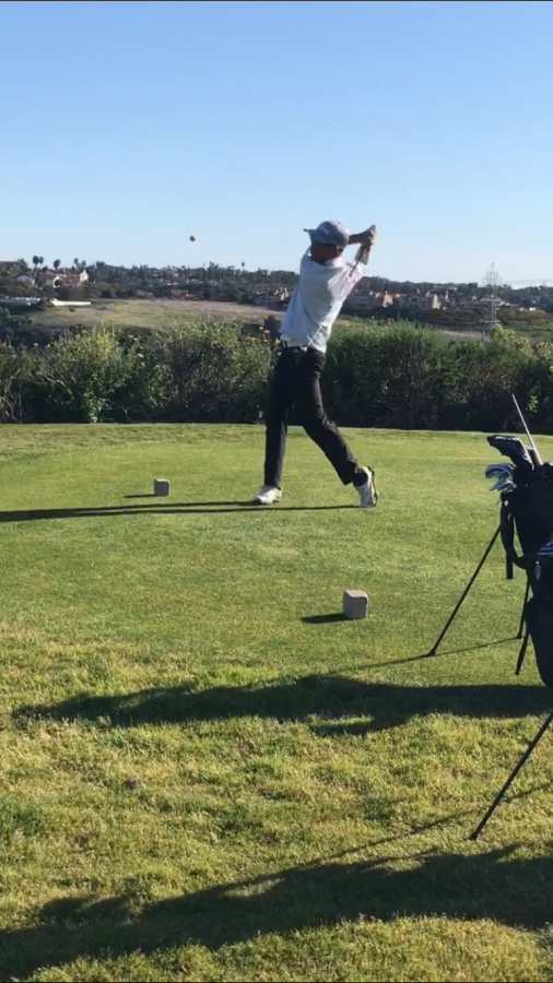 Sophomore David Yoon holds his finish after striping a drive down the middle of the fairway during his home match vs. Vista on Tuesday. The boys golf team has started off strong and hopes to carry this momentum into CIF finals.