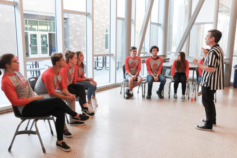 Members of Comedy Sportz, a competitive improvisational group, sit attentively awaiting instructions from the referee. Senior Allison DelGrande created the group to share and expand her love for theatre and acting to all members of the Sage Creek community.