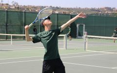 Andy Goh prepares to serve to his opponents. As a strong server, Goh helps his teammates prepare for tough competition.