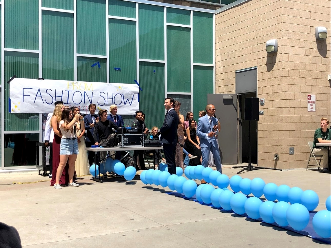 It%E2%80%99s+Prom+time+for+juniors+and+seniors%21+Sage+Creek+had+its+own+fashion+walk+to+see+what+students+outfits+are+for+prom.+Participating+in+the+fashion+walk+were+two+special+guests%2C+Fredrick+Griesbach+and+Dan+DeLeon.