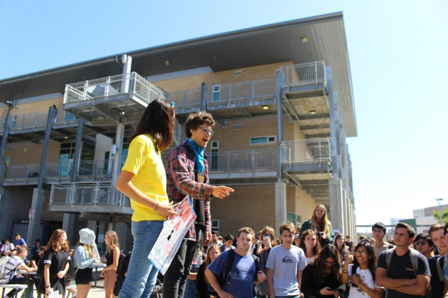 Seniors Samantha Low and Wiley Waggoner give speeches during the Climate Walkout on Friday, Sept. 20. The two students led and administered the walkout.