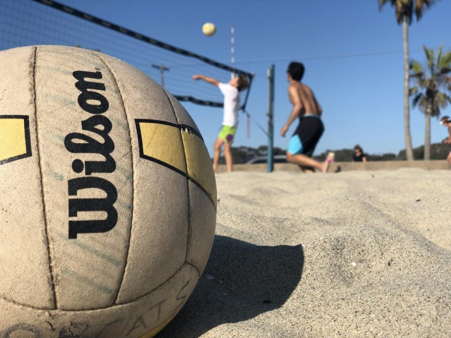 """Sophomore Marcus Delker and junior Nolan Mejia battle against Carlsbad High School in the crosstown rivalry scrimmage. They played at the """"Warm Waters"""" volleyball courts on Tuesday, Sept. 17."""