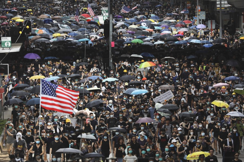 The+symbol+of+freedom+and+democracy+waves+in+the+streets+of+Hong+Kong+as+the+protests+rage+on.+