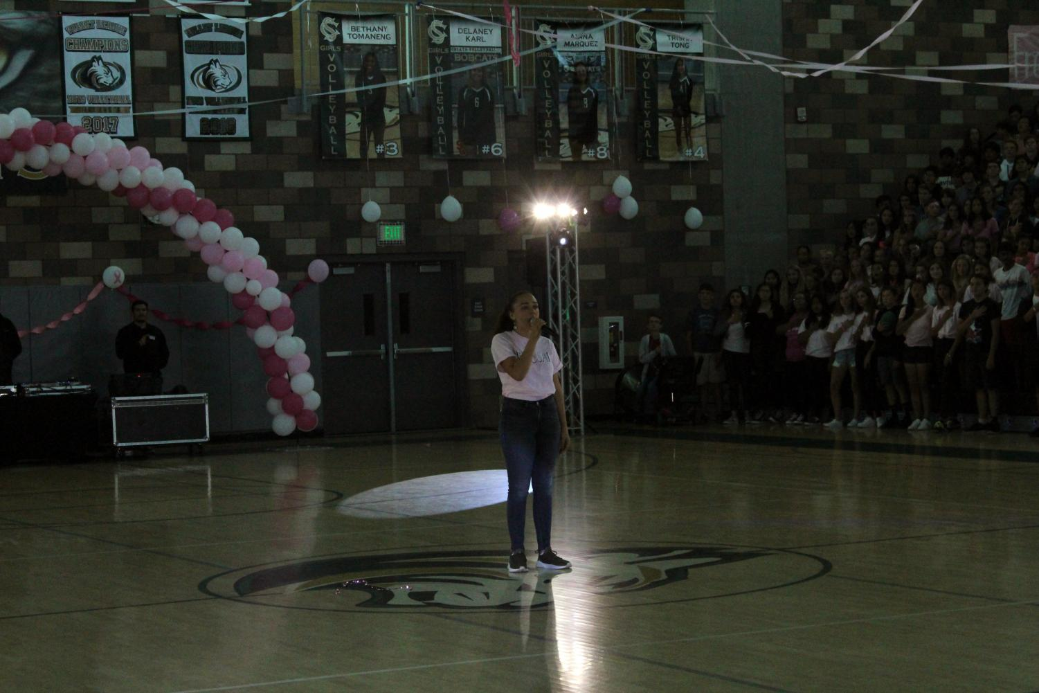 Priya+Richards+sings+the+%E2%80%9CStar-Spangled+Banner%E2%80%9D+for+the+students+of+Sage+Creek+before+the+pep+rally+on+Oct.+4.+The+pep+rally+encouraged+school+spirit+before+Sage+Creek%E2%80%99s+annual+Staff+vs.+Students+Flag+Football+tournament.