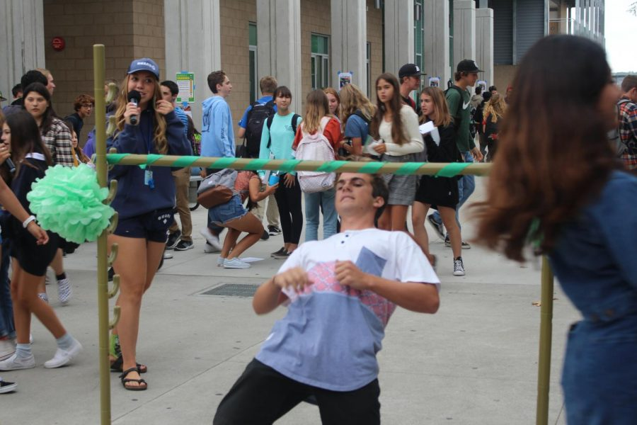 Senior Mikey Moran participates in Thursdays lunch limbo. As a part of Hello Week, ASB planned fun lunch activities, including this limbo competition for class cup points.