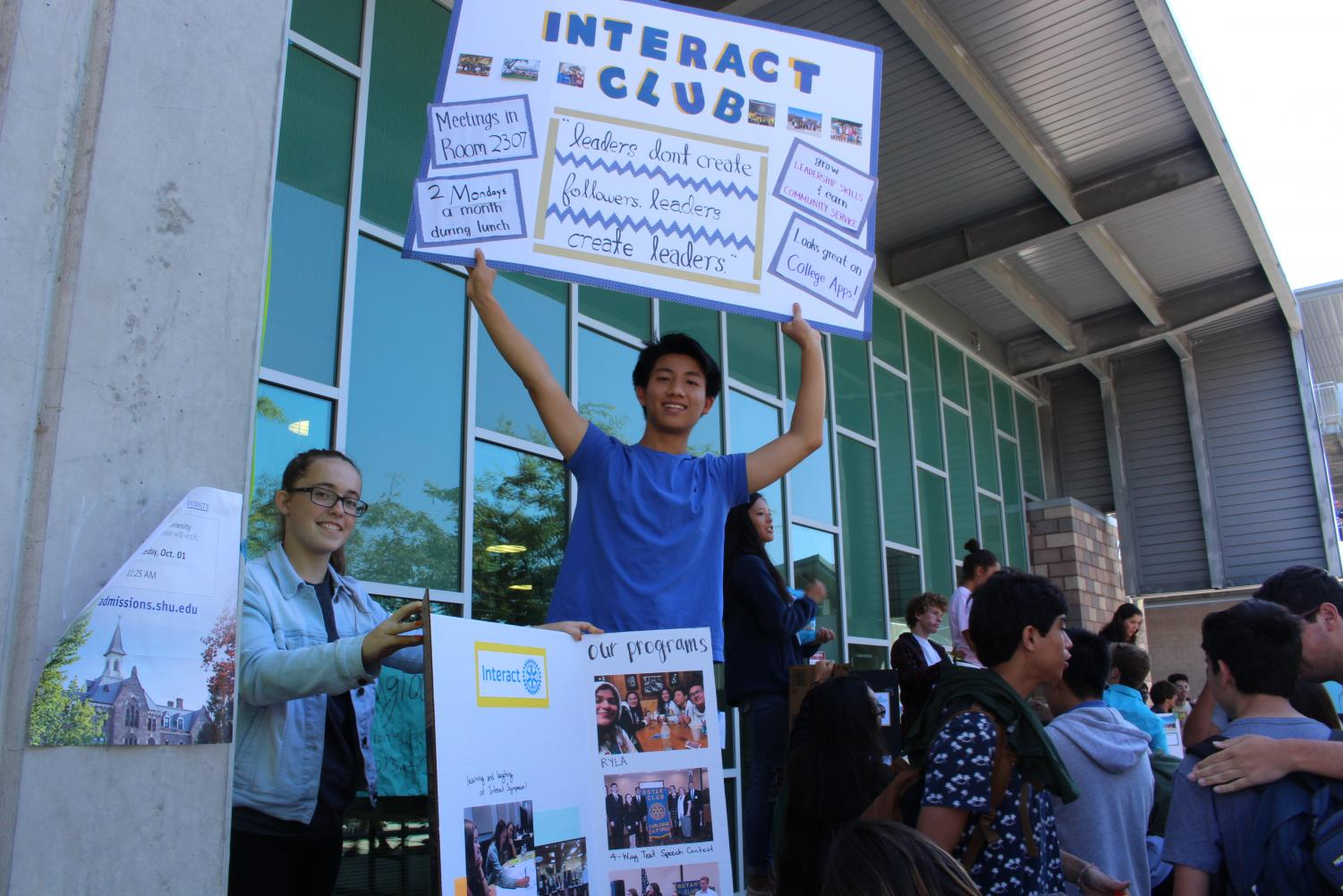 Interact+Club+holds+up+posters+to+promote+their+program+and+other+activities+they+do.+Club+Rush+took+place+on+Wednesday%2C+Oct.+2.