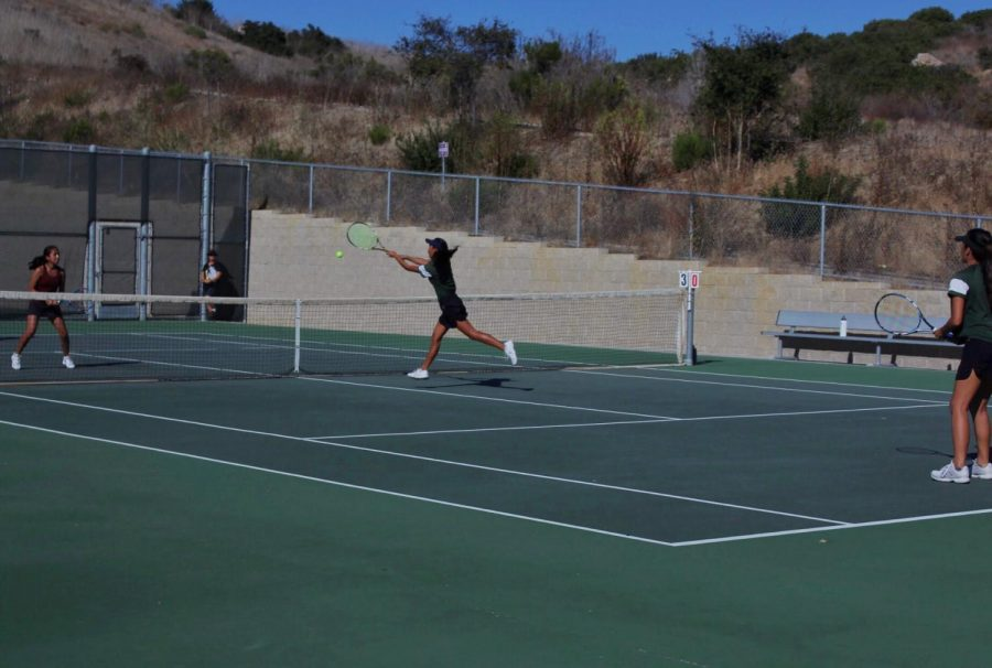 Sophomore Isla Leverette quickly dashes to the net for a strong hit. Girls tennis beat Rancho Buena Vista 3-5 on Oct. 3.