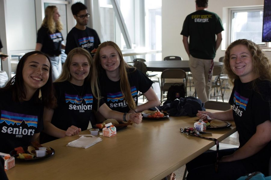 Seniors enjoy the pancake breakfast in the cafeteria after the senior panoramic photo. Last Wednesday, seniors chose their pick at the buffet line from items such as bacon and pancakes.