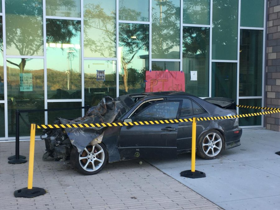 A wrecked car sat in front of the library this week as a reminder of the dangers of drunk driving.