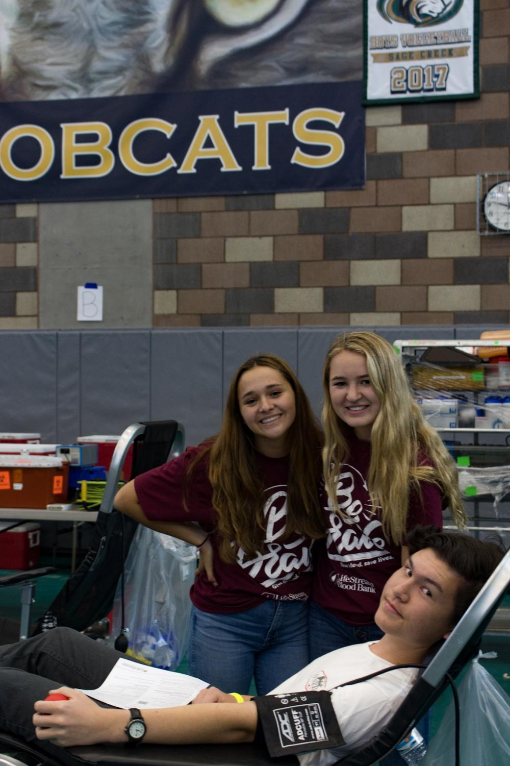 Senior+Christopher+Mou+donates+blood+in+the+Bobcat+Arena+with+the+assistance+of+two+helpers.+ASB+hosted+its+blood+drive+last+Tuesday+to+help+those+in+need+of+a+blood+donation.
