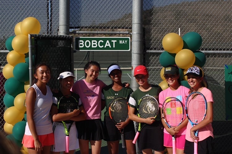 The+girls+varsity+tennis+team+poses+in+front+of+the+tennis+courts+to+celebrate+senior+night.+The+team+would+go+on+to+play+against+San+Dieguito+Academy.