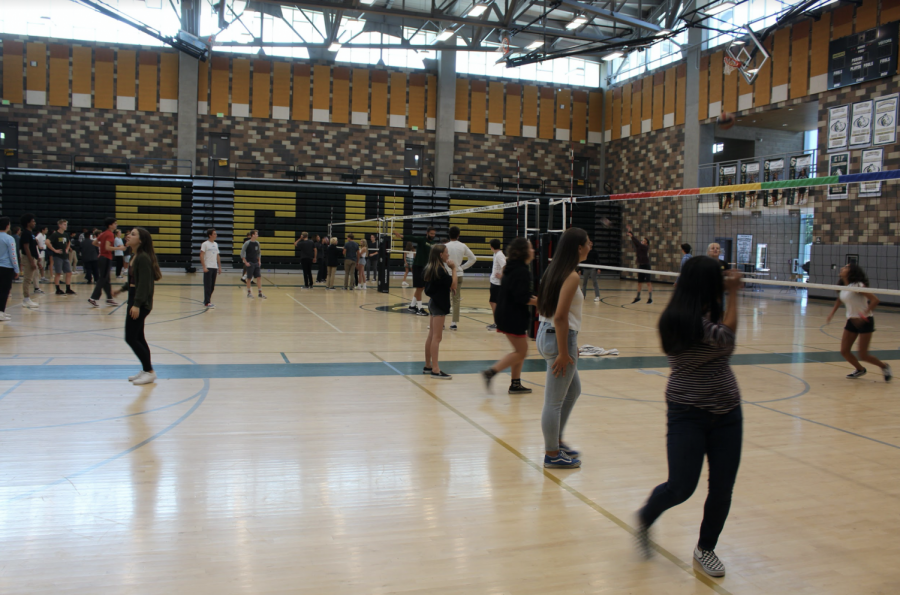 Students play volleyball in the gym during lunchtime. Most days at lunch, the gym is open for everyone to play volleyball.