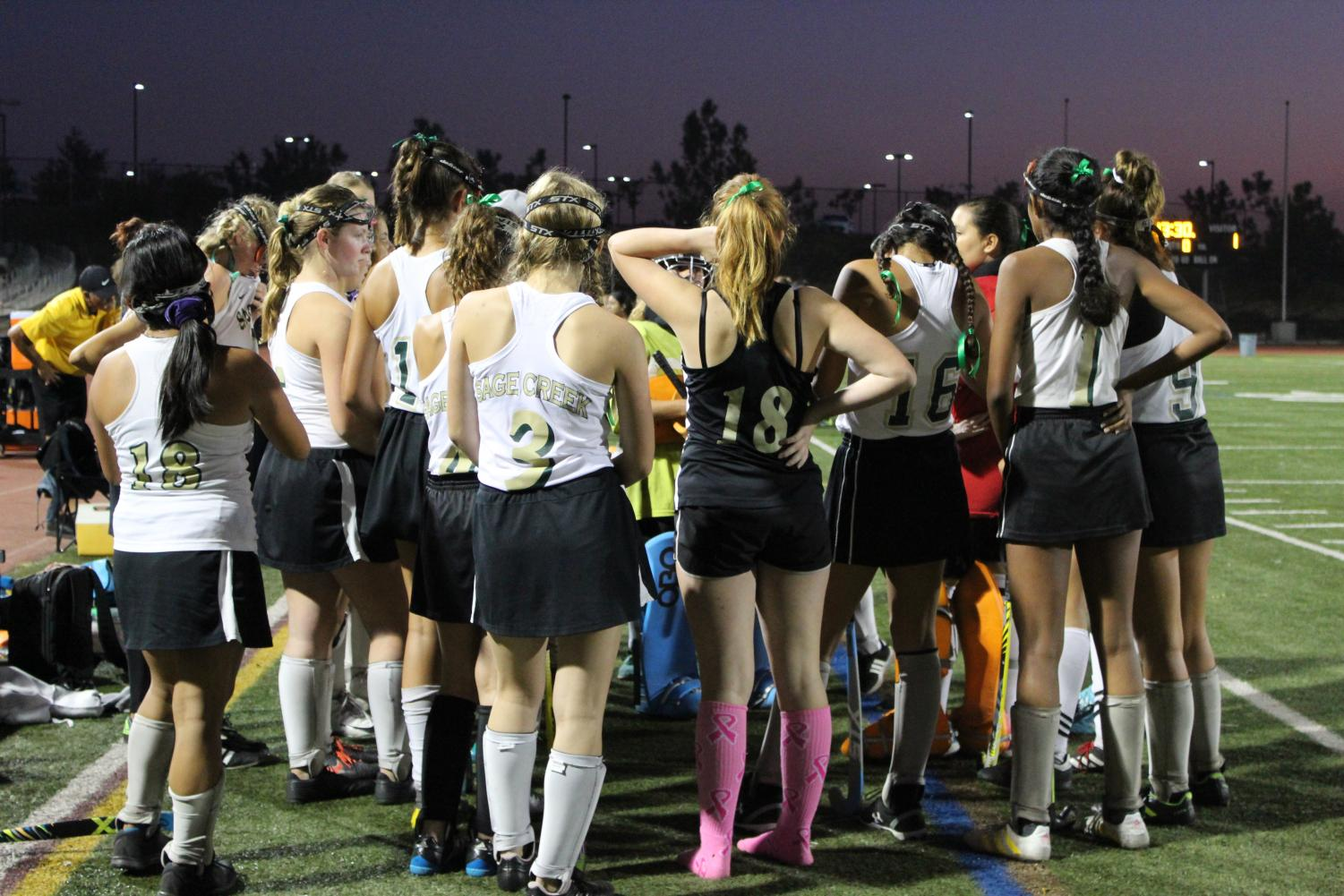 Girls+field+hockey+team+strategize+a+game+plan+then+come+in+for++a+team+huddle.+The+team+played+their+last+game+of+the+season+against+Vista+High+School.