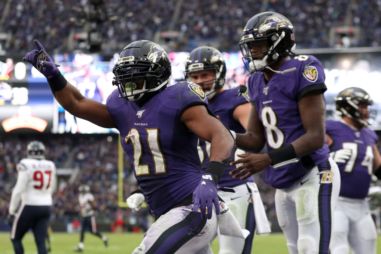 Ravens running back Mark Ingram Jr. celebrates after scoring his second touchdown of the game.