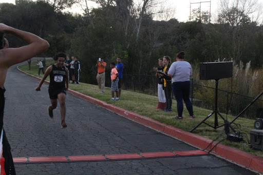 Diego+Garcia+flies+into+the+finish+with+a+5k+time+of+21%3A04.+As+he+is+a+senior%2C+this+race+was+his+final+high+school+cross+country+race.