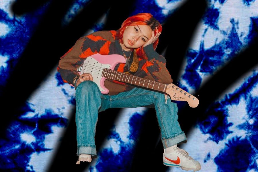 Beabadoobee poses with a pink electric guitar. Beabadoobee started publishing her music in 2017 onto Spotify and since then has toured the world and published an EP titled