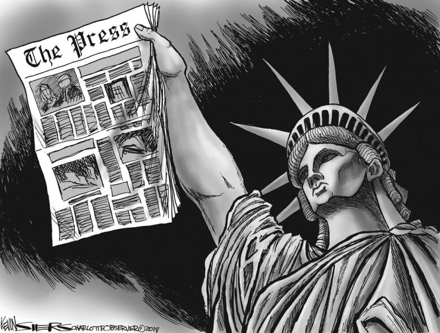 The Statue of Liberty upholding the newspaper to symbolize America's freedom of press. The topic of freedom of press dates all the way back to the creation of the printing press and carries on as a relevant topic into the modern day.