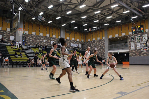 Sage Creek claims the ball and runs through Coronado's defense to gain the advantage. Sage Creek and Coronado were on the move as both teams tie up the points.