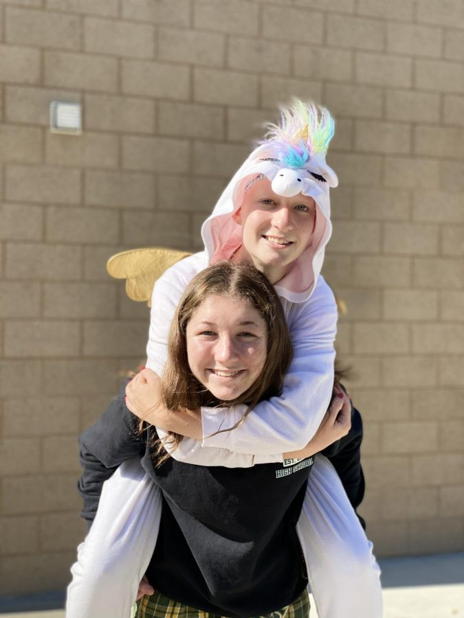 Junior Charissa Feldmann and Sophomore Finlay Hughes pose in their pajamas. In preparation for their game against El Camino, the girls basketball team decided on a theme of wearing pajamas to school.