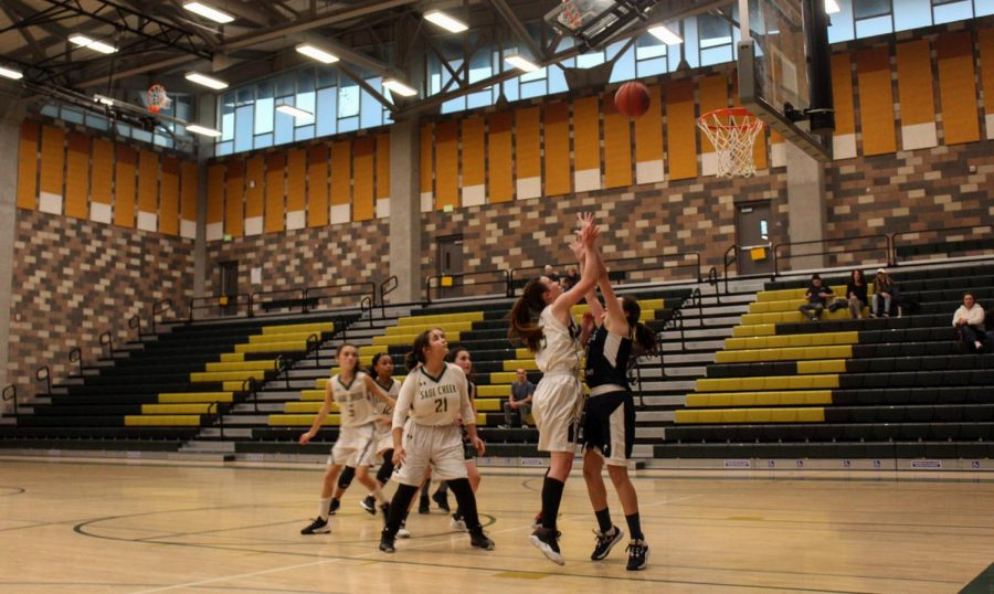Girls JV basketball play offensively against San Dieguito Academy. The game took place last Friday at home.
