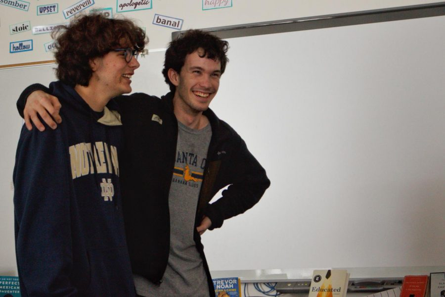 Wiley Waggoner (left) and Ben Hartley crack up while practicing improv for ComedySportz. The game they played forced them to speak in sync while a separate team alternated words.