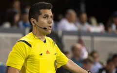 "Eduardo referees in for Major League Soccer and FIFA. ""I'm a professional assistant referee, so that means that my position is always on the sideline,"" Eduardo said."