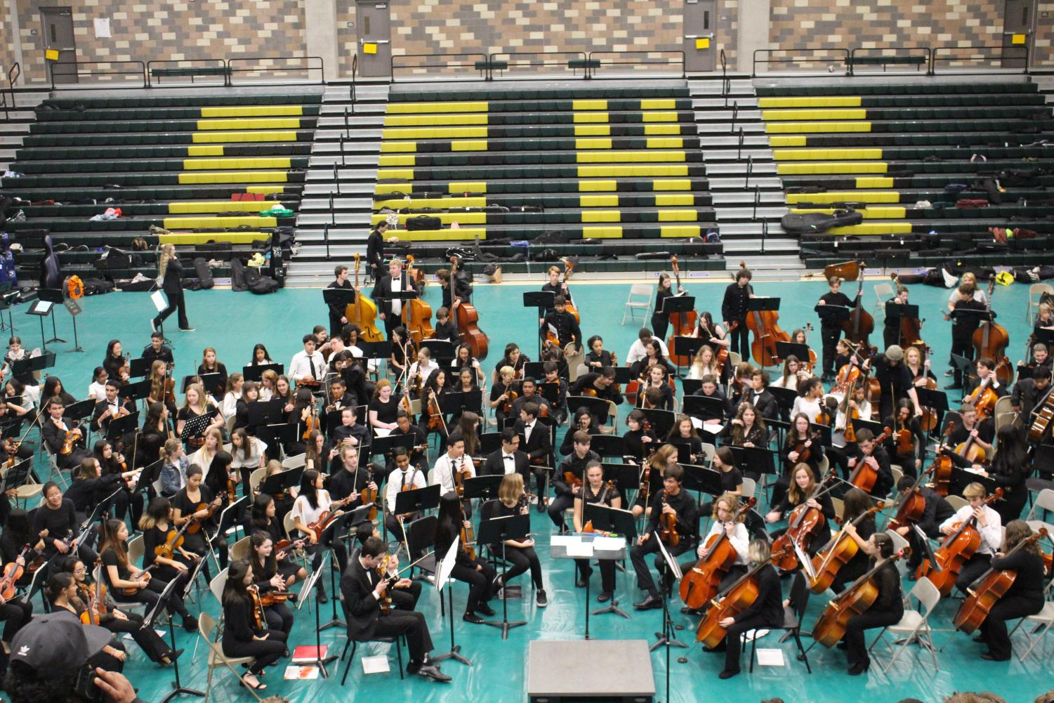 Students+prepare+to+perform+the+final+piece+for+the+CUSD+combined+orchestra+concert.+On+January+27%2C+CUSD+Middle+schools%2C+Hope+elementary+and+Sage+Creek+High+School+performed+all+together.