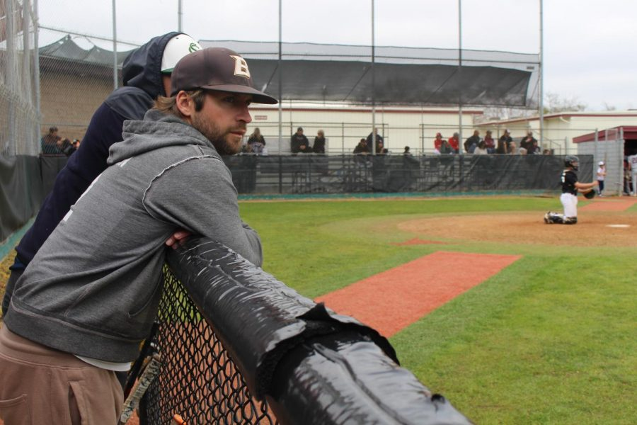 "Madsen leans against the fence at Rancho Buena Vista High School observing the Sage Creek JV team at a preseason game. Sage Creek played several teams in ""Winter Ball"" to prepare for the regular season of Divison 1 baseball."