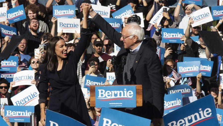 Presidential candidate Bernie Sanders stands with Alexandria Ocasio Cortez House Representative of New Yorks 14 district at his rally in Iowa. This rally turned out to be extremely successful and in the weeks following he has become the Democratic frontrunner.
