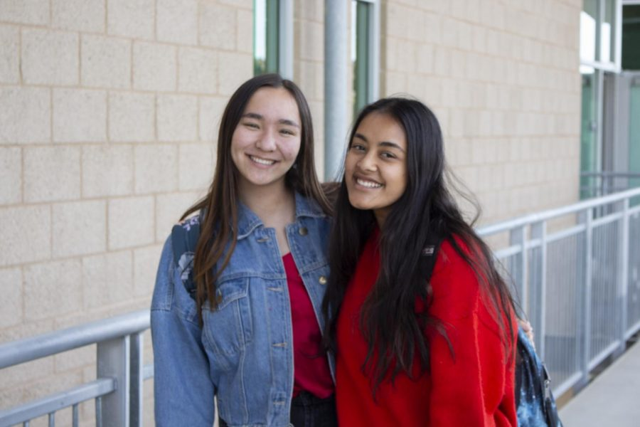 Juniors Charlotte Wiggins and Miral Ahmed show off their spirit wear for Wednesday's theme: class colors.
