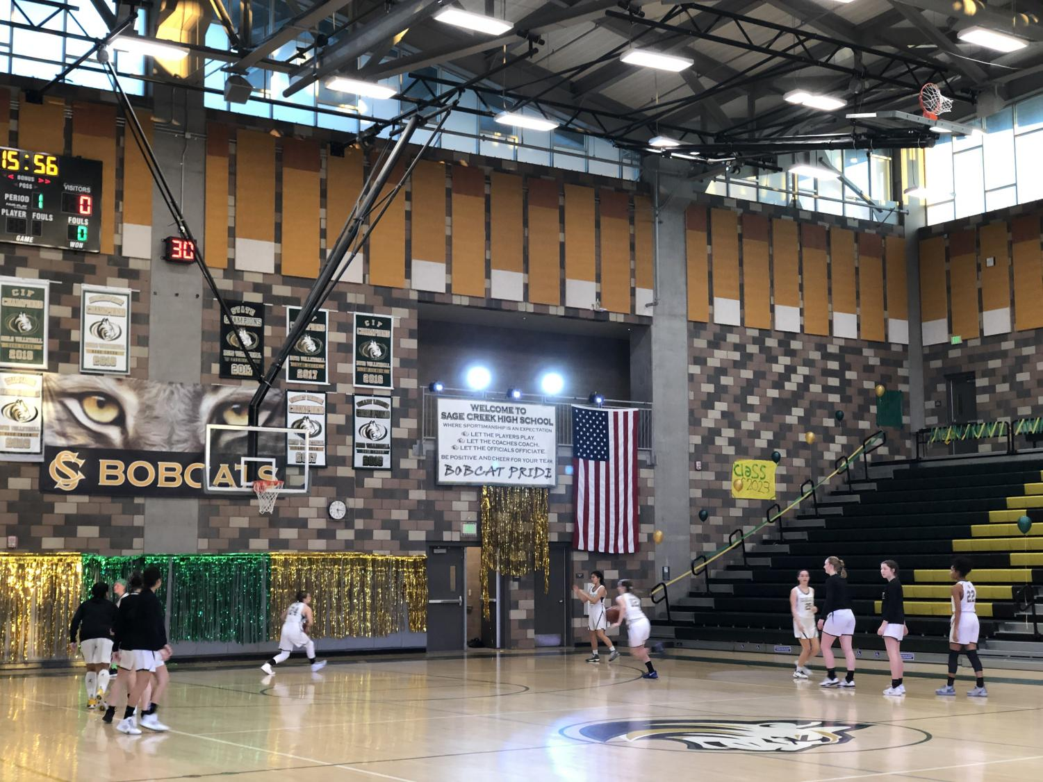 Varsity+girls+basketball+warming+up+for+their+much+anticipated+hoopcoming+game+against+Oceanside.+They+defeated+Oceanside+in+an+exciting+game+Friday%2C+Feb+7.