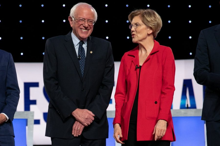 Senator Sanders and Warren talk and laugh at the July 30-31, 2019 Democratic debate in Michigan. The next debate will be held March 15, 2020.