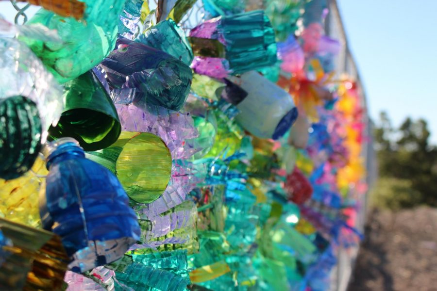 Students+have+transformed+recycled+water+bottles+into+the+coral+instillation+outside+the+2000s+building.+They+are+already+decorating+for+Festival+of+the+Arts.+