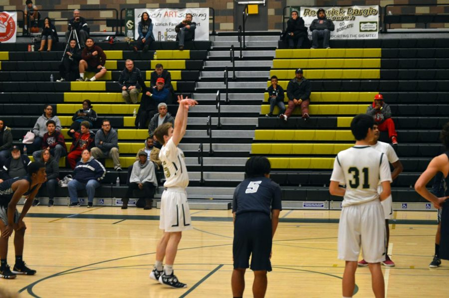 JV captain sophomore Carson Olander shoots a free throw in a game last season against Madison High School. The JV team had the best record of any basketball team at Sage this year.
