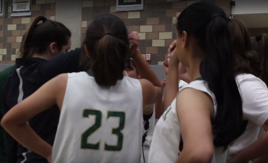 Girls JV basketball faces off against Oceanside, huddling up at halftime. The players fought hard but lost 36-40.