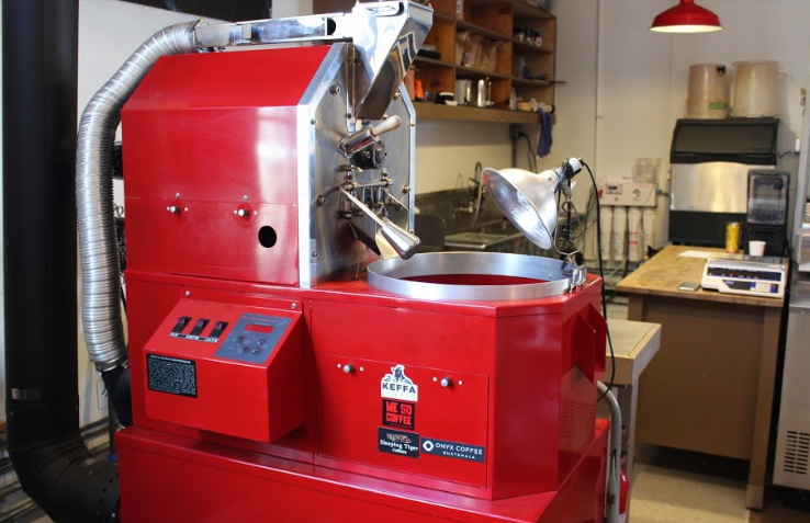 Roasting+coffee+can+be+an+art.+This+one+is+a+Primo+roasting+coffee+machine+used+to+roast+Sleeping+Tigers+Coffee+in+house+for+their+customers.