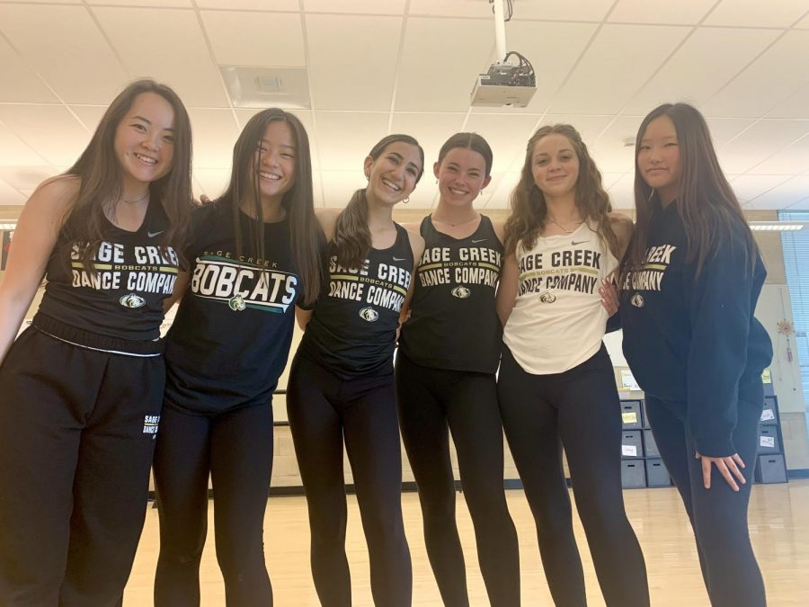 Sage Creek dance company poses for a photo. Dance company has been diligently practicing throughout the basketball season to perform at half time shows and continues to practice for their spring dance show.