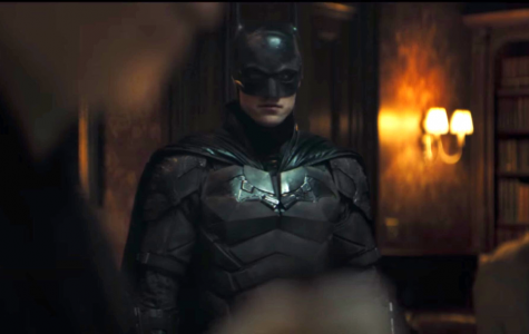 Batman investigating one of the riddler's crime scenes. As he walked up to commissioner Gordon, Gordon showed Batman a letter, a letter he found attached to the murder victim.