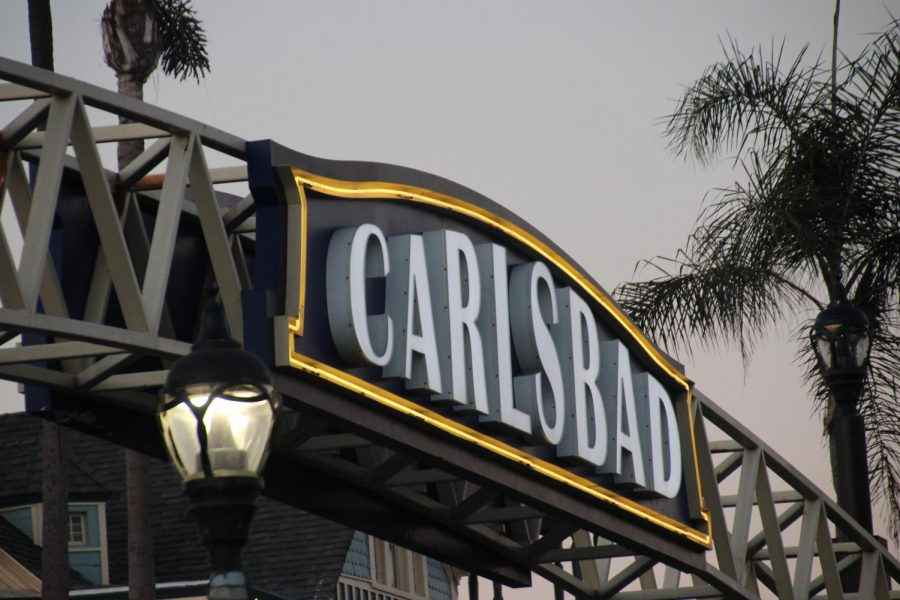 The iconic Carlsbad sign illuminates the sky as night falls. As the sun began to set, the Carlsbad sign lit up the streets in the village.
