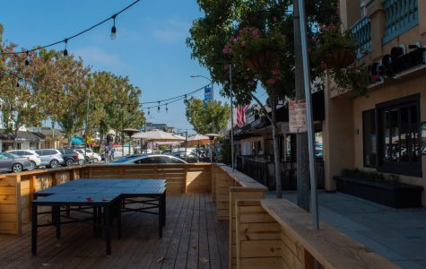 A Carlsbad restaurant creates a temporary patio in their parking lot, allowing extra suitable seating due to the coronavirus pandemic. Many businesses have been given the green light by local governments to temporarily expand into streets in order to replace their lost indoor space.