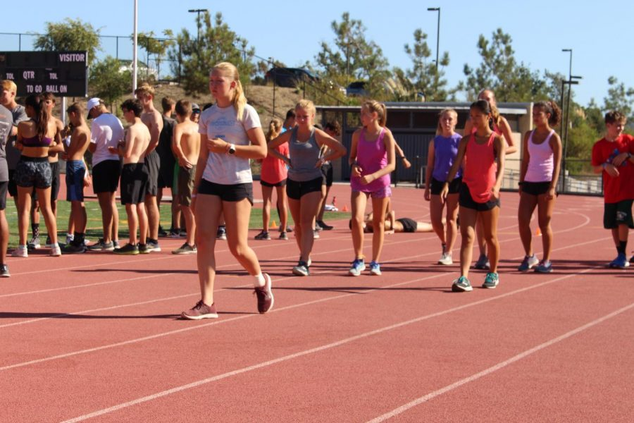 The Cross Country team works hard in the harsh fall heat. Although students have found some ways to continue playing their sport, they miss competing alongside their peers.