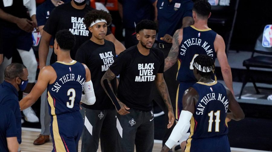 NBA players stand with the Black Lives Matter movement by wearing phrases in place of their names. Most NBA players have opted to wear phrases.